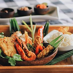 Shrimps and squids on Balinese-style seafood platter menu