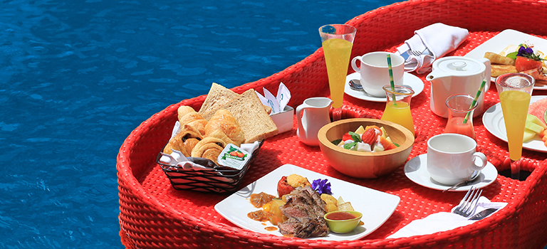 a breakfast menu served on floating tray at pool