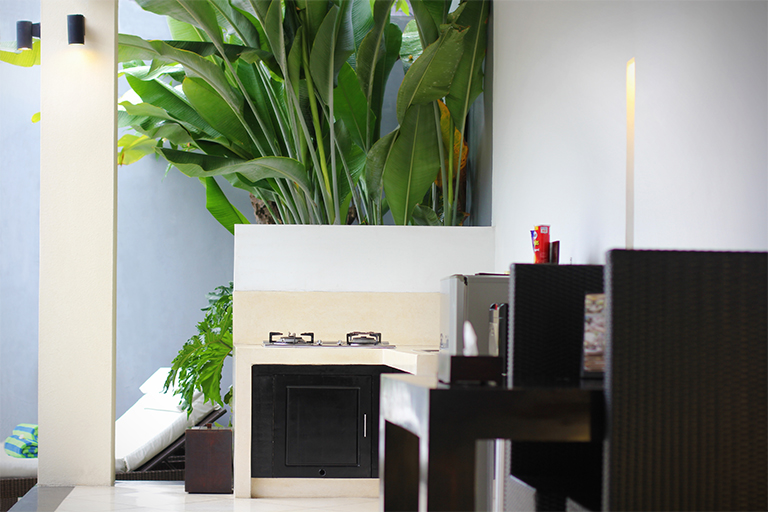 Fully equipped kitchenette integrated with dining space at private villa