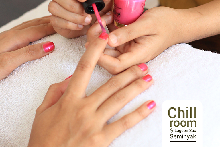 Theraphist using OPI nail polish to create the nail art