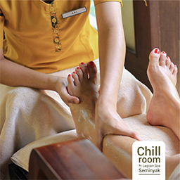 Therapist applies technique of foot massage therapy