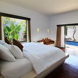 Bedroom facing pool view with window close to the garden