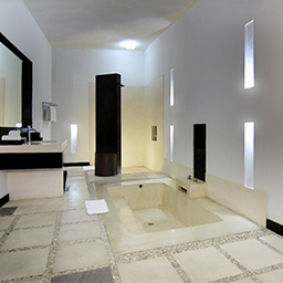 En-suite villa bathroom design with rain shower and huge bathtub