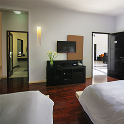 Twin bedroom set with TV and en-suite bathroom.