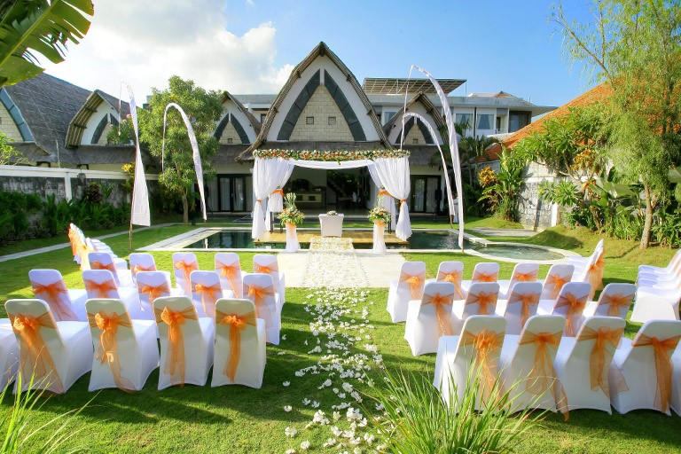 Wedding aisle with white colors setup, flower decoration, and floating altar