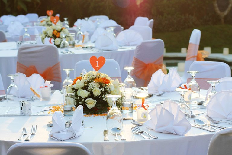 Table decoration with floral centerpieces for wedding reception